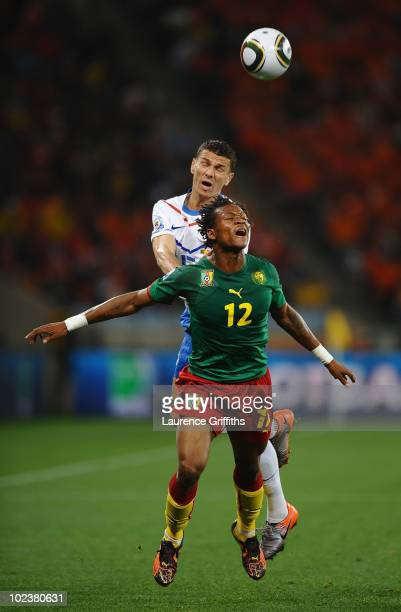 Khalid Boulahrouz of the Netherlands pushes Gaetan Bong of Cameroon as they jump for the ball during the 2010 FIFA World Cup South Africa Group E...