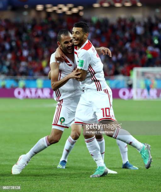 Khalid Boutaib of Morocco celebrates after scoring his team's first goal with teammate Younes Belhanda during the 2018 FIFA World Cup Russia group B...