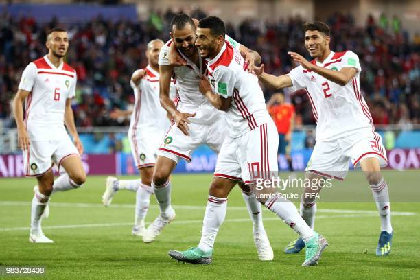Khalid Boutaib of Morocco celebrates with teammates after scoring his team's first goal during the 2018 FIFA World Cup Russia group B match between...