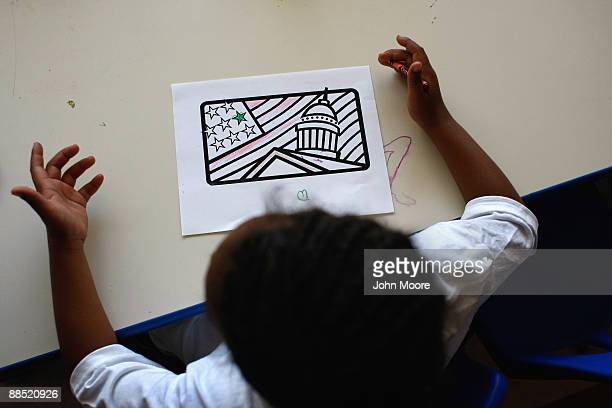 Khalid Johnson, age 8, asks for more crayons while coloring an American flag at the Family Gateway family homeless shelter on June 15, 2009 in...
