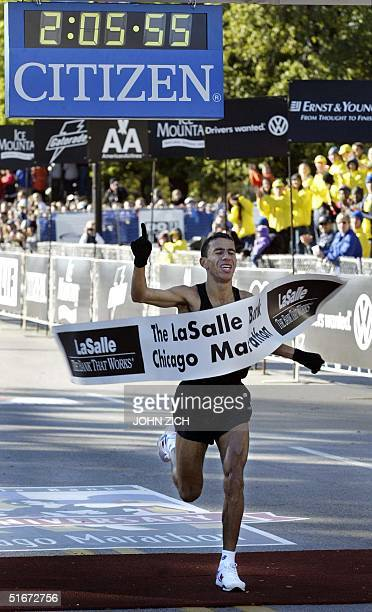 Khalid Khannouchi of the United States crosses the finish line and wins the Chicago Marathon 13 October 2002 with an official time of 20556 The...