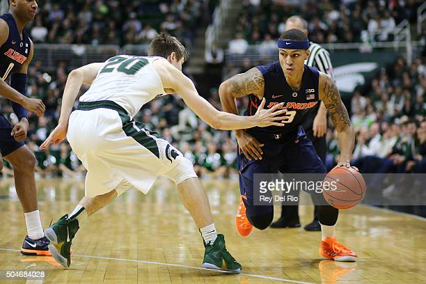 Khalid Lewis of the Illinois Fighting Illini drives to the basket against Matt McQuaid of the Michigan State Spartans in the first half at the...