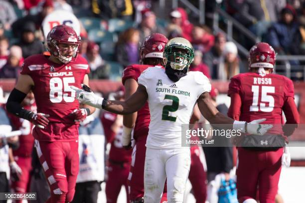 Khalid McGee of the South Florida Bulls reacts in front of Chris Myarick and Anthony Russo of the Temple Owls in the second quarter at Lincoln...