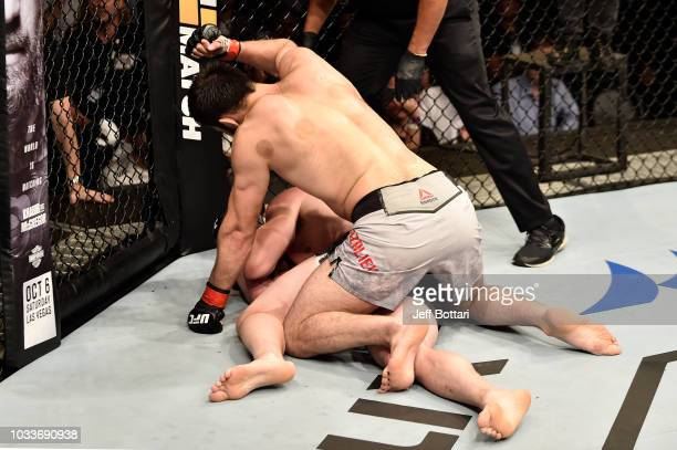 Khalid Murtazaliev of Russia punches CB Dollaway in their middleweight bout during the UFC Fight Night event at Olimpiysky Arena on September 15 2018...