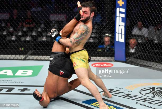 Khalid Taha of Germany kicks Bruno Silva of Brazil in their bantamweight fight during the UFC 243 event at Marvel Stadium on October 06, 2019 in...
