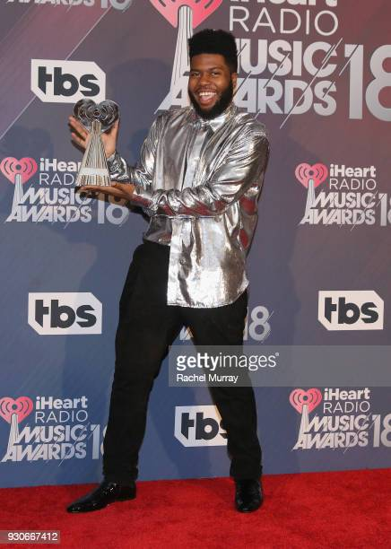 Khalid winner of the RB Artist of the Year and Best New RB Artist awards poses in the press room during the 2018 iHeartRadio Music Awards which...