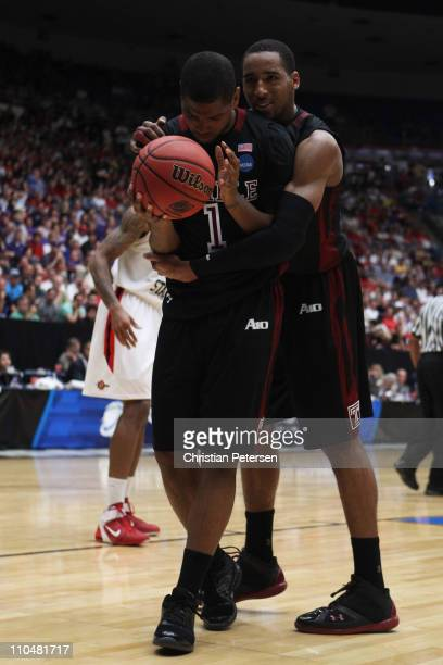 Khalif Wyatt and Rahlir Jefferson of the Temple Owls react during double overtime against the San Diego State Aztecs in the third round of the 2011...