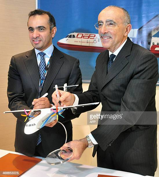 Khalifa AlDaboos , managing director of Dubai Aerospace and ATR chief executive Filippo Bagnato pose after a signing ceremony during the Singapore...