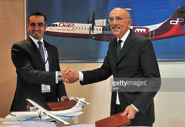 Khalifa AlDaboos , managing director of Dubai Aerospace shakes hands with ATR chief executive Filippo Bagnato at a signing ceremony during the...