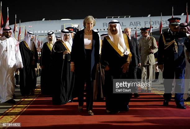 Khalifa bin Salman Al Khalifa the Prime Minister of Bahrain accompanies British Prime Minister Theresa May as she arrives at Sakhir Airbase on...