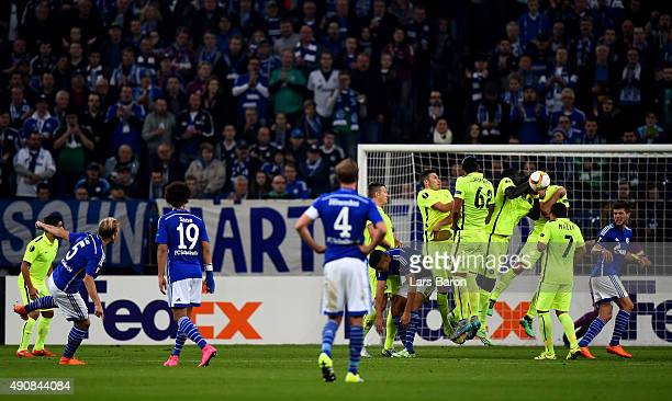 Khalifa Sankare of Asteras blocks a free kick of Johannes Geis of Schalke with his arm during the UEFA Europa League Group K match between FC Schalke...