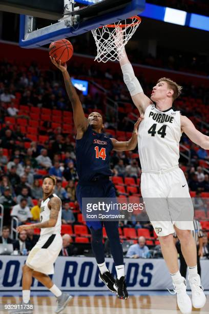 Khalil Ahmad of the Cal State Fullerton Titans goes up for a shot around C Isaac Haas of the Purdue Boilermakers during the NCAA Division I Men's...