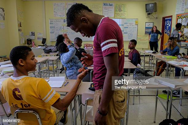 Khalil Bridges and Antonio Christian chat during Women's Literature class at Renaissance Academy on Tuesday April 19 in Baltimore MD Khalil Bridges...