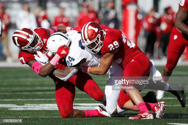 Khalil Bryant and Raheem Layne of the Indiana Hoosiers tackle Miles Sanders of the Penn State Nittany Lions in the second quarter of the game at...