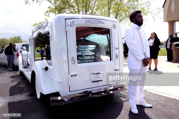 Khalil Bryant stands next to a hearse carrying the remains of his 16-year-old sister Ma'Khia Bryant following her funeral at First Church of God on...