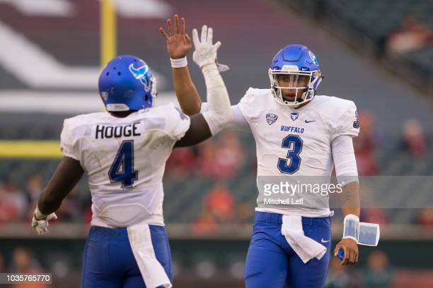 Khalil Hodge and Tyree Jackson of the Buffalo Bulls both hold up four fingers to signify the fourth quarter against the Temple Owls at Lincoln...