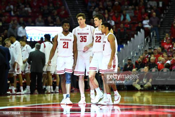 Khalil Iverson Nate Reuvers Ethan Happ and D'Mitrik Trice of the Wisconsin Badgers walk onto the court to start the second half against the Grambling...