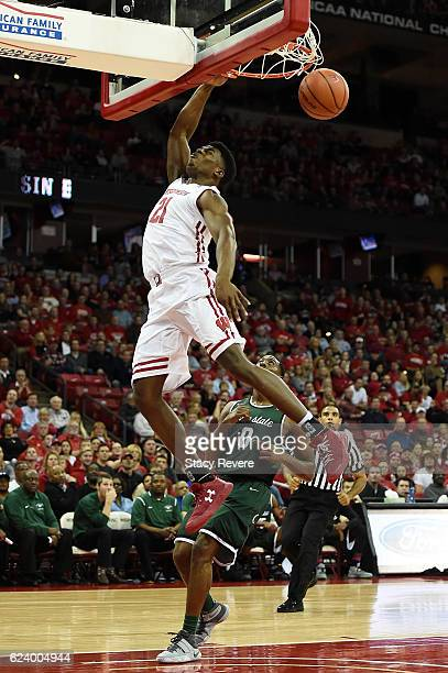 Khalil Iverson of the Wisconsin Badgers dunks in front of Glen Burns of the Chicago State Cougars during the first half of a game at the Kohl Center...