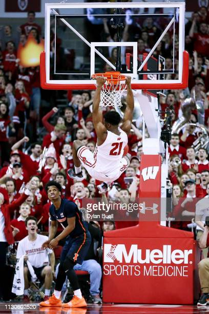Khalil Iverson of the Wisconsin Badgers dunks the ball over Trent Frazier of the Illinois Fighting Illini in the first half at the Kohl Center on...