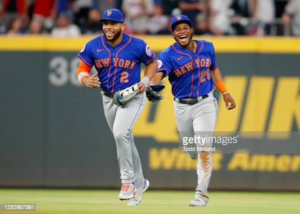 Khalil Lee and Dominic Smith of the New York Mets celebrate their win after an MLB game against the Atlanta Braves at Truist Park on May 17, 2021 in...