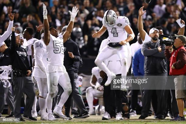 Khalil Mack and Derek Carr of the Oakland Raiders celebrate after the Michael Crabtree touchdown is confirmed by officials to tie their game 3030...