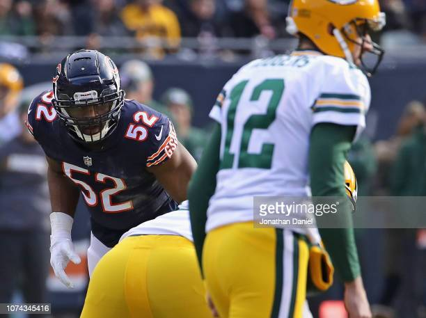 Khalil Mack of the Chicago Bears awaits the snap against Aaron Rodgers of the Green Bay Packers at Soldier Field on December 16 2018 in Chicago...