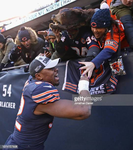 Khalil Mack of the Chicago Bears celebrates with fans after a win against the Green Bay Packers at Soldier Field on December 16 2018 in Chicago...