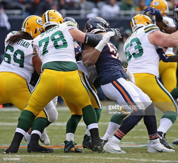Khalil Mack of the Chicago Bears completes a backward sack of Aaron Rodgers of the Green Bay Packers while being blocked by Jason Spriggs at Soldier...