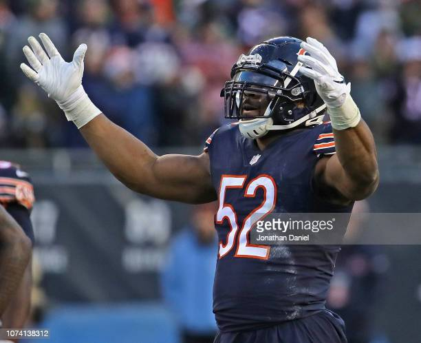 Khalil Mack of the Chicago Bears encourages the crowd to cheer during a game against the Green Bay Packers at Soldier Field on December 16 2018 in...