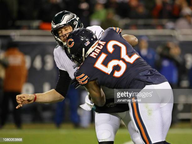 Khalil Mack of the Chicago Bears hits Nick Foles of the Philadelphia Eagles during an NFC Wild Card playoff game at Soldier Field on January 6 2019...