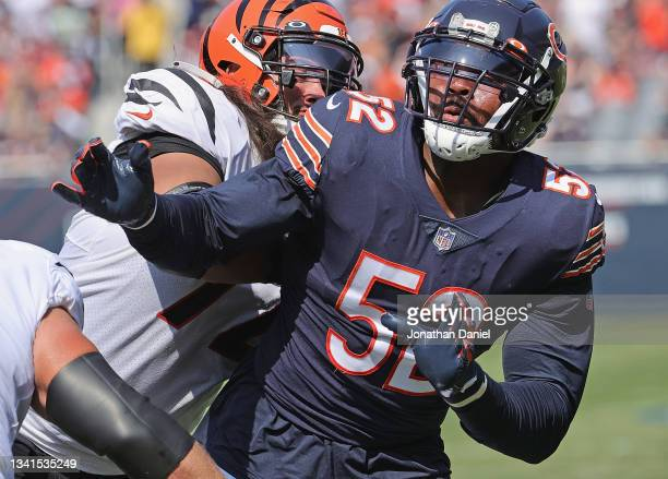 Khalil Mack of the Chicago Bears is blocked in the back by Xavier Su'a-Filo of the Cincinnati Bengals at Soldier Field on September 19, 2021 in...