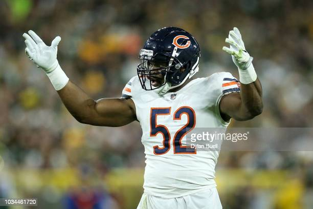 Khalil Mack of the Chicago Bears pumps up the crowd in the third quarter against the Green Bay Packers at Lambeau Field on September 9 2018 in Green...