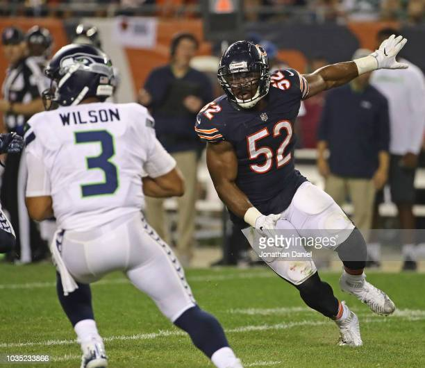 Khalil Mack of the Chicago Bears ruahes Russell Wilson of the Seattle Seahawks at Soldier Field on September 17 2018 in Chicago Illinois The Bears...