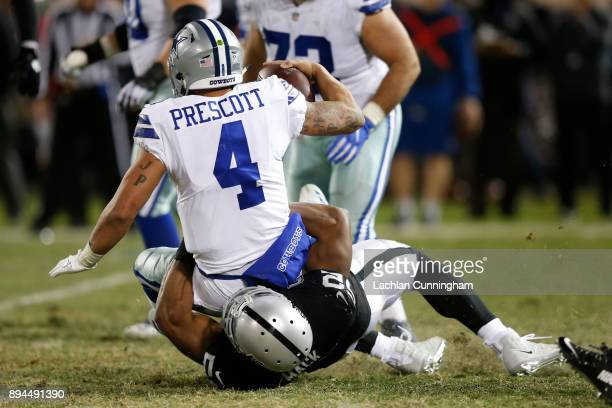 Khalil Mack of the Oakland Raiders sacks Dak Prescott of the Dallas Cowboys during their NFL game at OaklandAlameda County Coliseum on December 17...