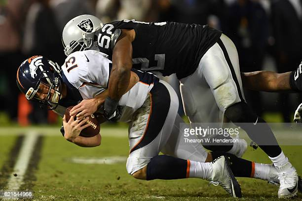 Khalil Mack of the Oakland Raiders sacks Trevor Siemian of the Denver Broncos in their game at OaklandAlameda County Coliseum on November 6 2016 in...