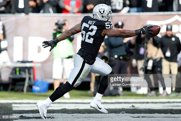 Khalil Mack of the Oakland Raiders scores after intercepting Cam Newton of the Carolina Panthers in the second quarter of their NFL game on November...
