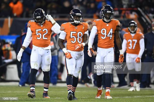 Khalil Mack Roquan Smith and Leonard Floyd of the Chicago Bears take the field during a game against the Minnesota Vikings at Soldier Field on...