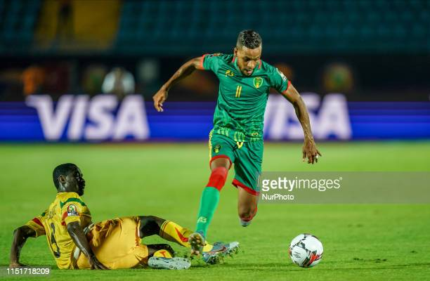 Khalil Moulay Ahmed of Mauritania going past Diadie Samassekou of Mali during the 2019 African Cup of Nations match between Mali and Mauritania at...