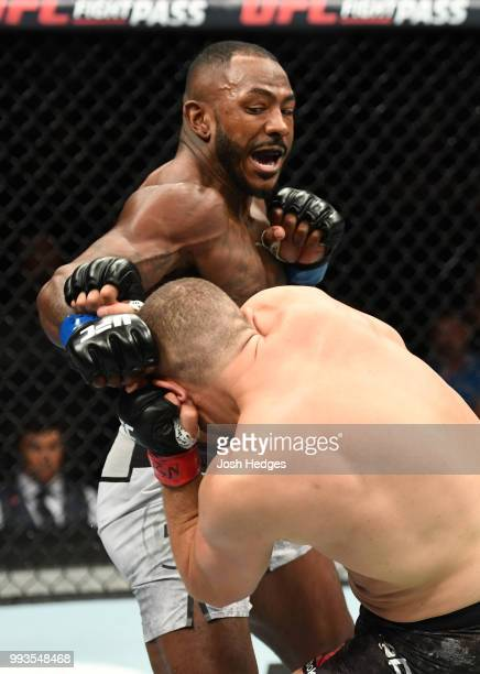 Khalil Rountree Jr. Punches Gokhan Saki of Turkey in their light heavyweight fight during the UFC 226 event inside T-Mobile Arena on July 7, 2018 in...