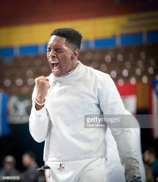 Khalil Thompson of the USA celebrates a victory in the Junior Men's Sabre competition at the Cadet and Junior PanAmerican Fencing Championships on...