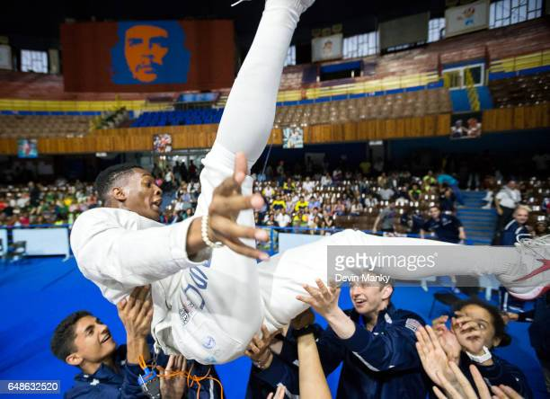 Khalil Thompson of the USA is hoisted into the air by his teammates to celebrate a gold medal victory in the Junior Men's Sabre competition at the...