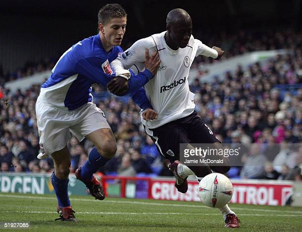Khalilou Fadiga of Bolton battles with Scott Mitchell of Ipswich during the FA Cup Third Round match between Ipswich Town and Bolton Wanderers at...