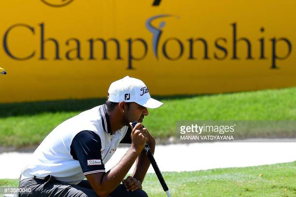 Khalin Joshi of India lines up a putt on the 18th hole during the third round of the 2018 Maybank Malaysia Golf Championship at Saujana Golf and...