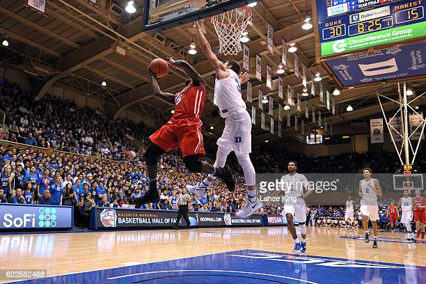 Khallid Hart of the Marist Red Foxes goes to the basket against Grayson Allen of the Duke Blue Devils at Cameron Indoor Stadium on November 11 2016...