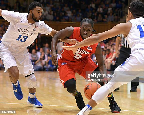 Khallid Hart of the Marist Red Foxes moves the ball against Matt Jones and Frank Jackson of the Duke Blue Devils at Cameron Indoor Stadium on...