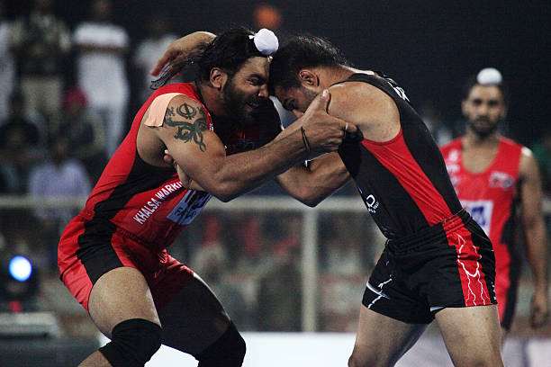 Khalsa Warriors compete against Punjab Thunder during the 2014 World Kabaddi league tournament at Punjab Agricultural University Hockey Stadium on...