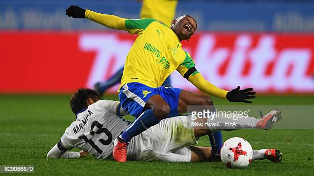 Khama Billiat of Mamelodi Sundowns is fouled by Atsutaka Nakamura of Kashima Antlers during the FIFA Club World Cup second round match between...