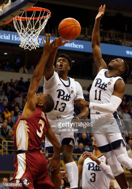 Khameron Davis of the Pittsburgh Panthers blocks a shot against Trent Forrest of the Florida State Seminoles at Petersen Events Center on January 14...