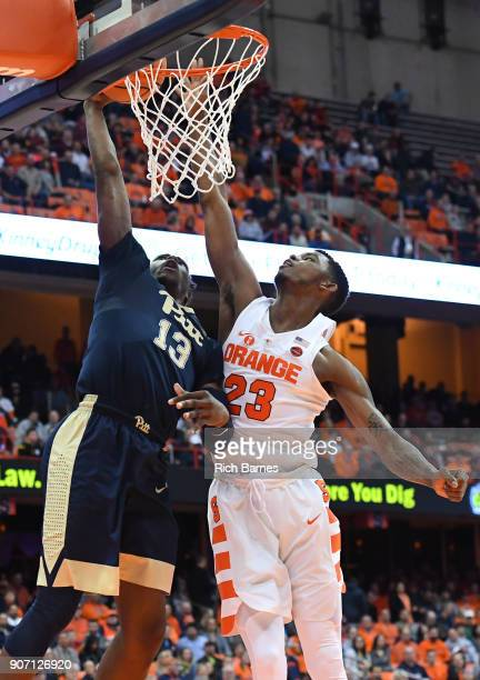 Khameron Davis of the Pittsburgh Panthers drives to the basket for a shot as Frank Howard of the Syracuse Orange defends during the first half at the...