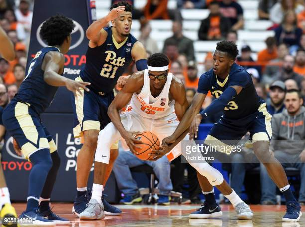 Khameron Davis of the Pittsburgh Panthers reaches for the ball controlled by Paschal Chukwu of the Syracuse Orange during the first half at the...